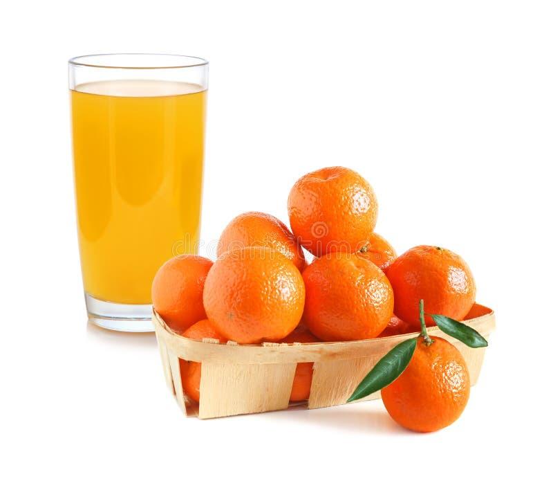 Jugo y mandarinas de la fruta cítrica fotografía de archivo