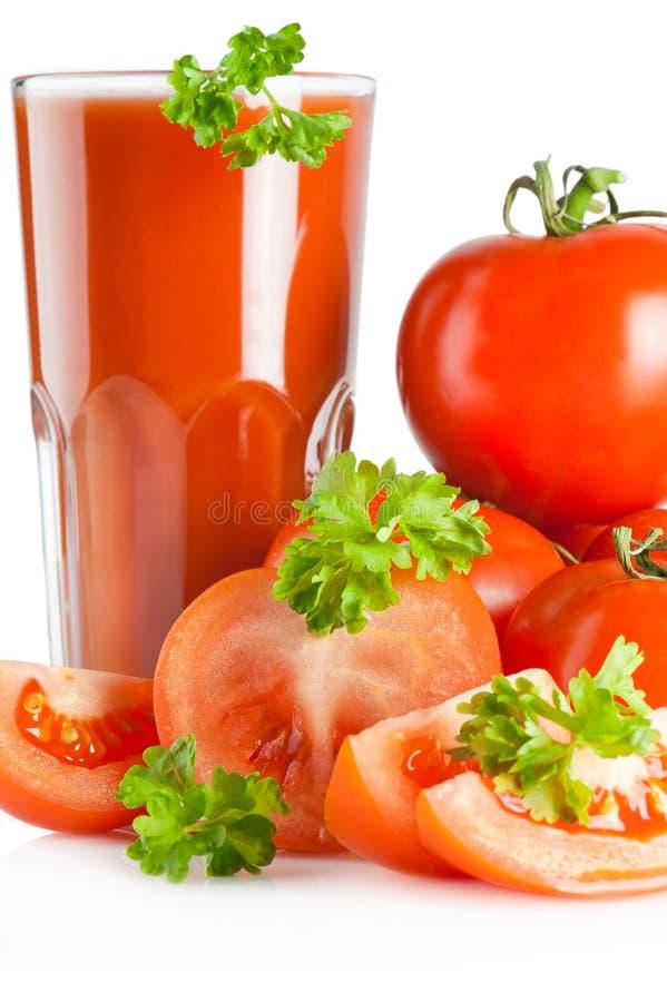 Jugo y perejil de tomate fotografía de archivo libre de regalías
