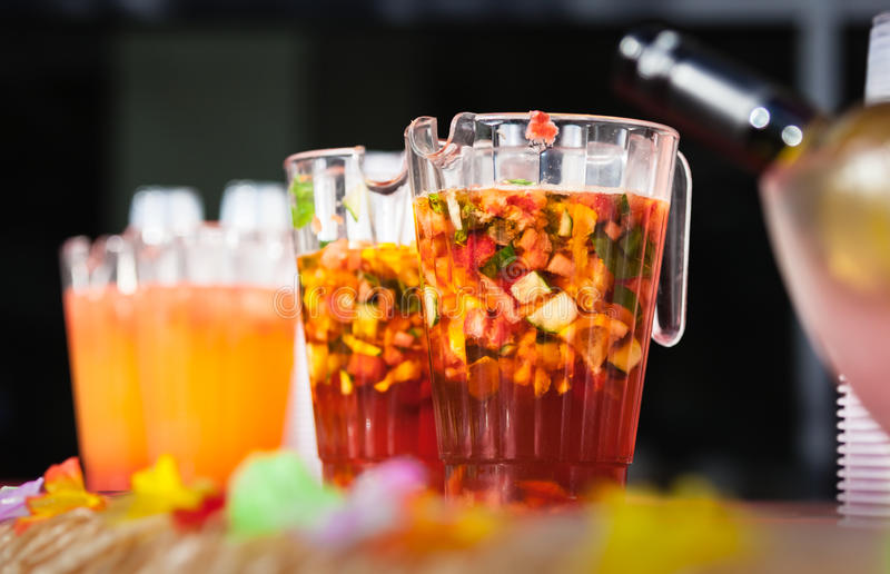 Jugs of alcohol punch. Jugs containing alcoholic fresh fruit punch to be served for guests royalty free stock images