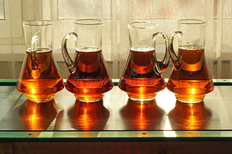 Jugs with apple juice. Vintage canteen and jugs with apple juice royalty free stock photos
