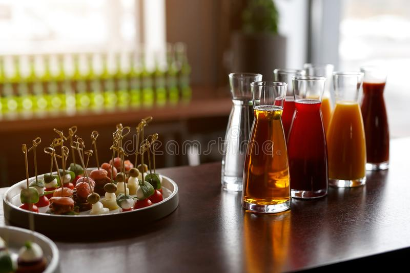 Jugs with different juices on event catering royalty free stock image