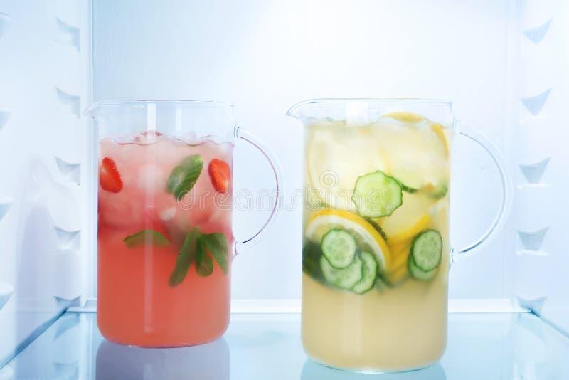 Jugs of fresh lemonade. In fridge stock photo