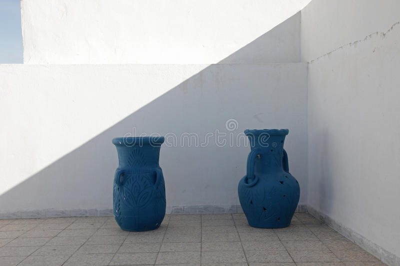 Jugs. In front of a white wall royalty free stock photo
