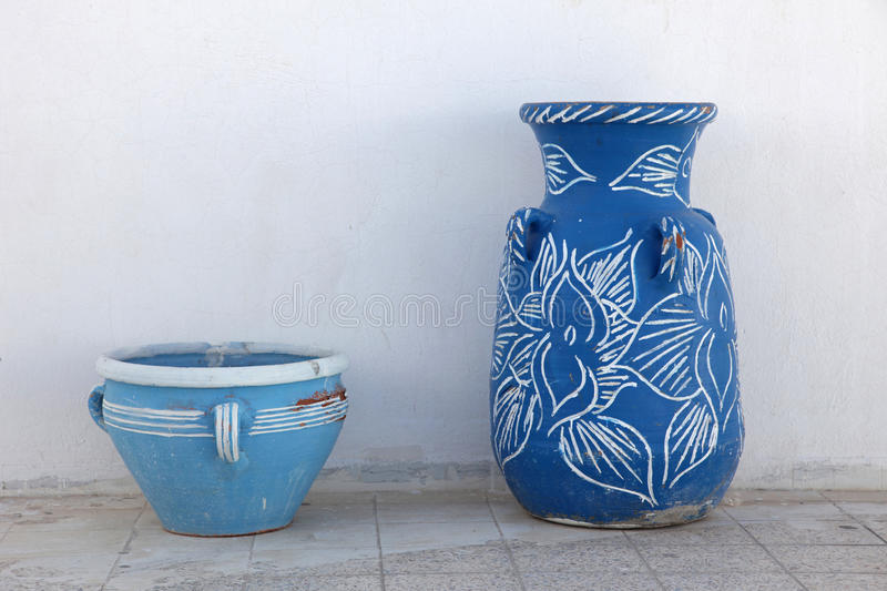 Jugs. In front of a white wall stock photo
