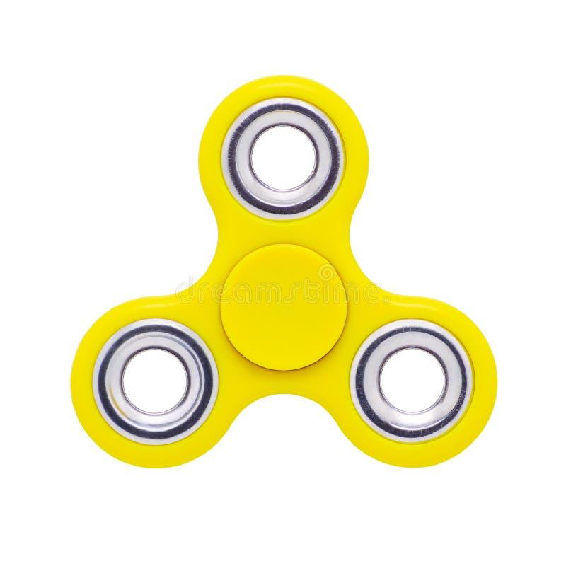 Juguete anti de la tensión del amarillo del hilandero del finger de la persona agitada aislado en blanco foto de archivo libre de regalías