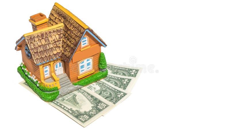 Juguete de la casa en billetes de banco del dinero imagen de archivo libre de regalías