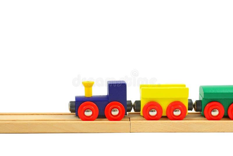 Juguete de madera del tren en los carriles en blanco imagen de archivo libre de regalías