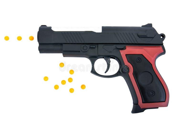 Juguete del arma de la pistola aislado en el fondo blanco El juguete del arma de la pistola aisló Juguete de la pistola con la ba imágenes de archivo libres de regalías