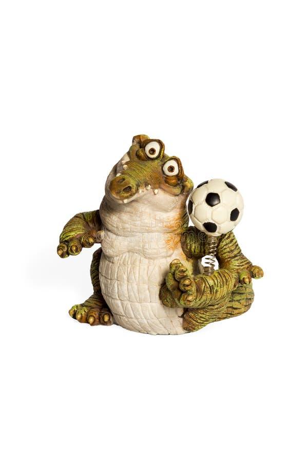 Juguete del cocodrilo con una bola fotografía de archivo libre de regalías