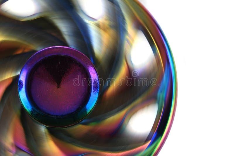 juguete del hilandero del metal del color foto de archivo