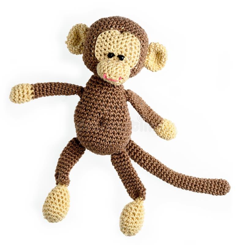 Juguete del mono aislado en blanco foto de archivo libre de regalías