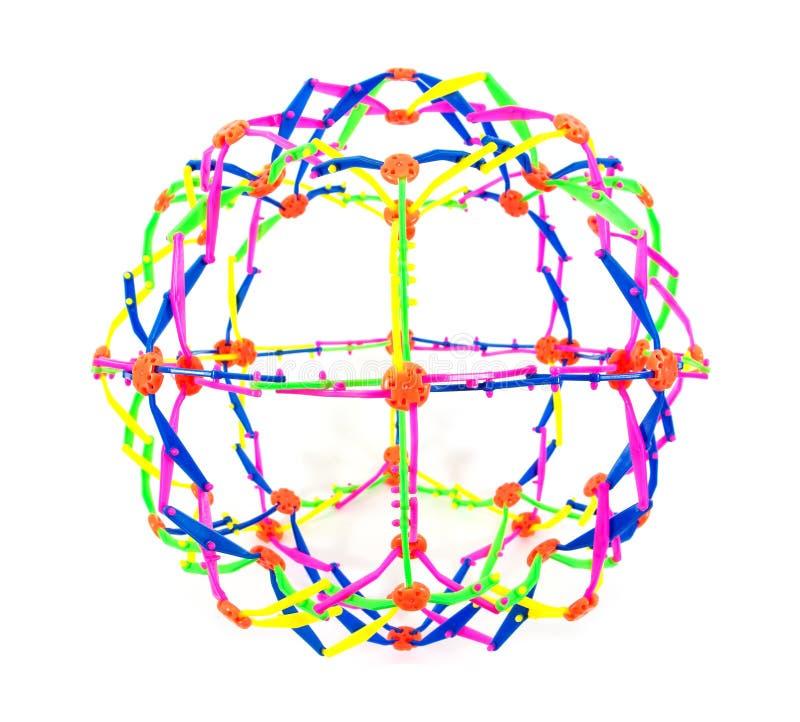 Juguete plástico de la bola del estiramiento aislado en el fondo blanco El juguete colorido de la bola del estiramiento aisló fotografía de archivo