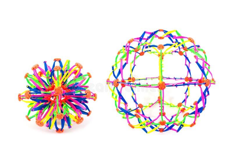 Juguete plástico de la bola del estiramiento dos aislado en el fondo blanco El juguete colorido de la bola del estiramiento aisl? imagen de archivo