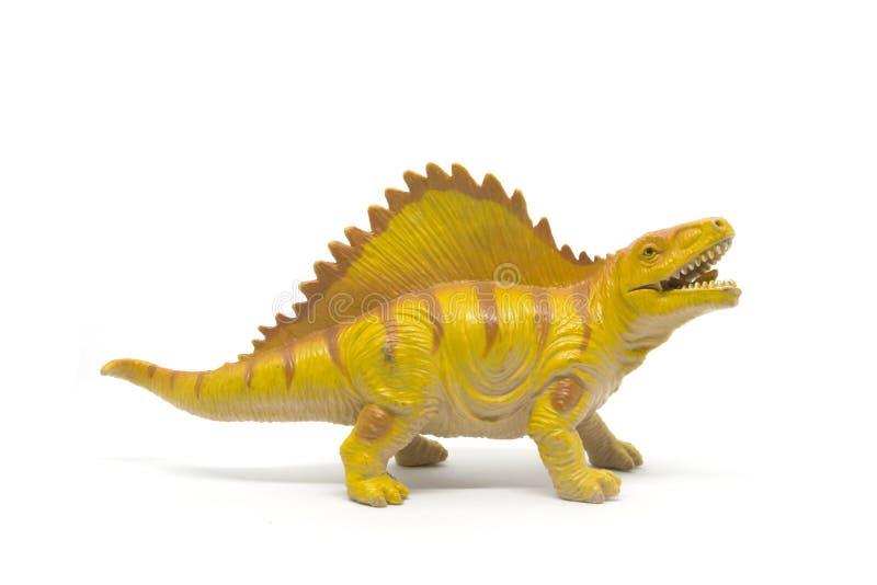 Juguete pl?stico del dinosaurio aislado en el fondo blanco imágenes de archivo libres de regalías