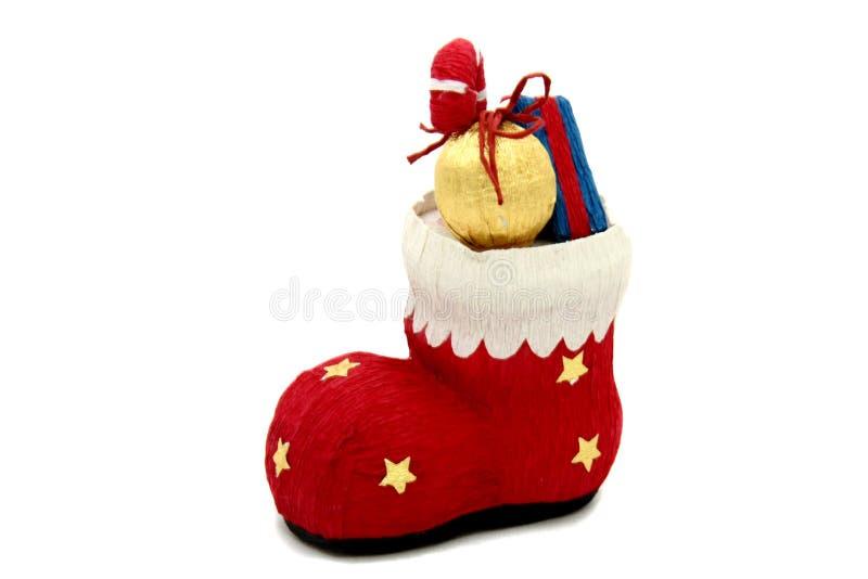 Juguete rojo del árbol de navidad de la bota por completo de presentes fotos de archivo libres de regalías
