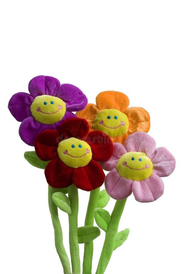 Juguete sonriente de la flor fotos de archivo