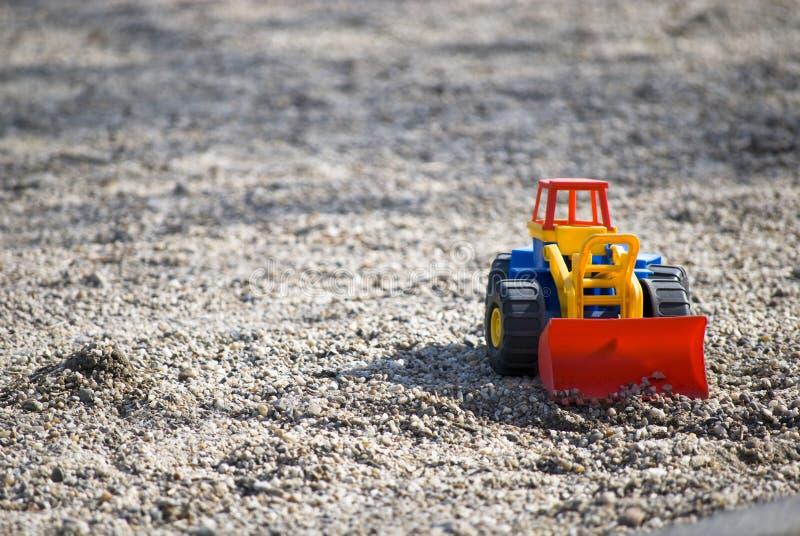 Juguetes en la arena fotografía de archivo libre de regalías