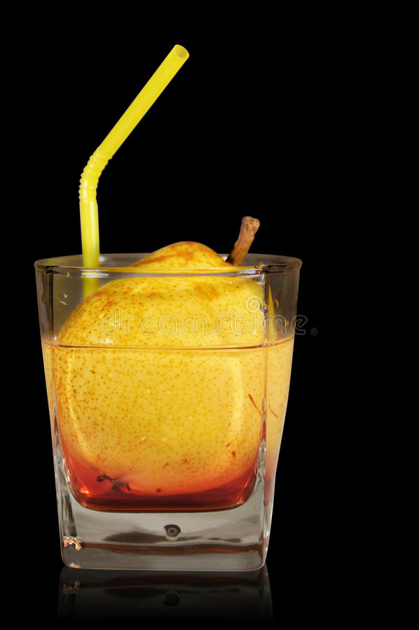 Juice. Cocktail from pear on black background with tubule royalty free stock images