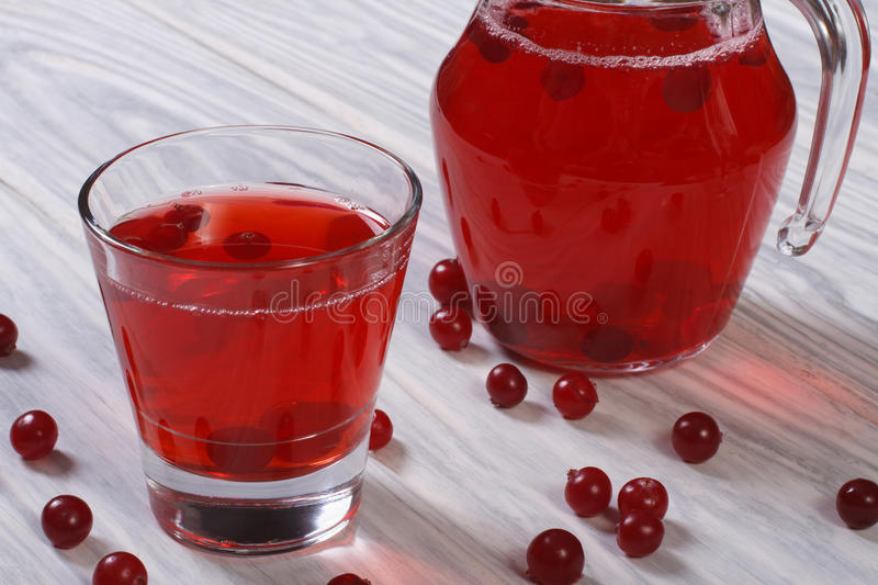 Juice from the berries of red cranberries royalty free stock image
