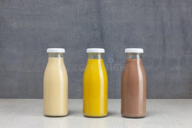 Juice Bottle Mock-Up - tre flaskor arkivbilder