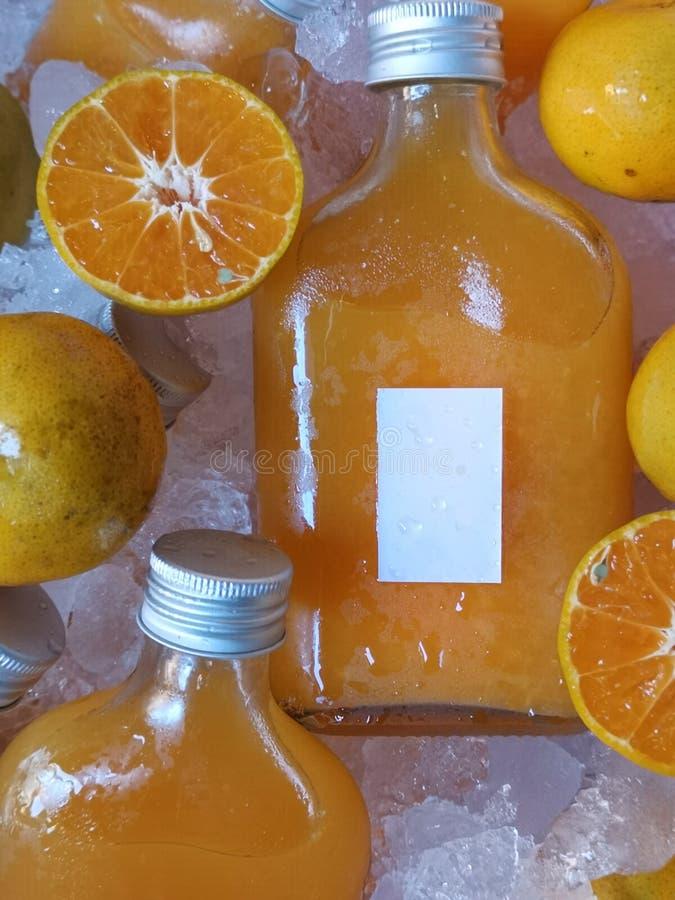Juice Bottles anaranjado fotos de archivo libres de regalías
