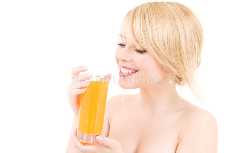 Juice. Bright picture of lovely girl with glass of juice stock photos