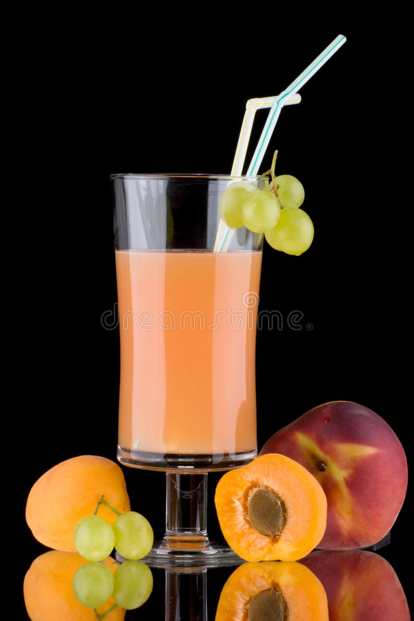 Juice and fresh fruits - organic, health drinks se. Organic juice made from apricots, grapes and peaches surrounded by fresh fruits. Series about organic and royalty free stock photos