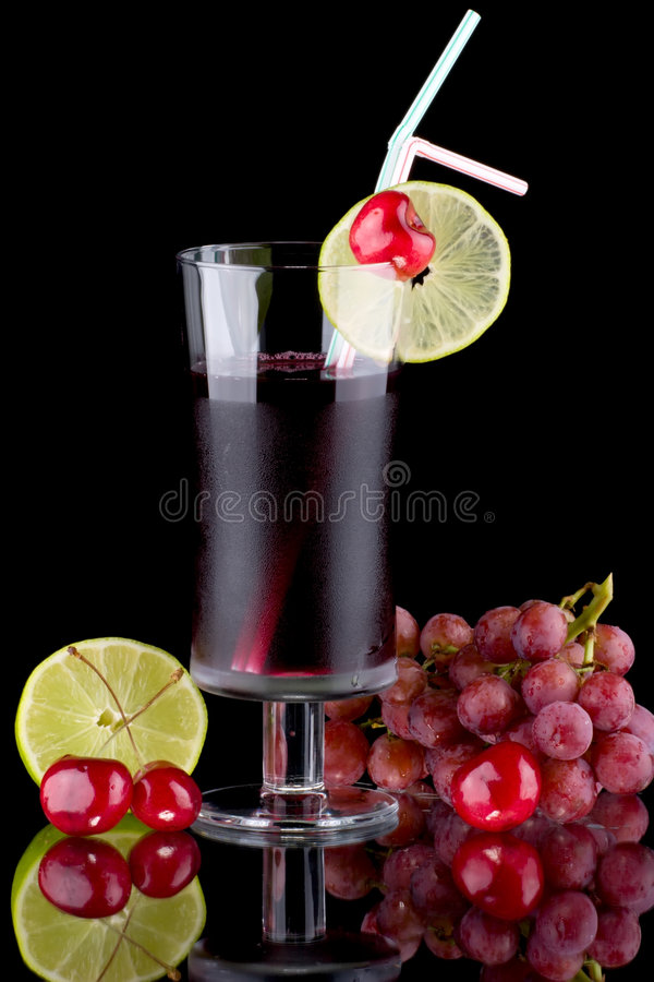 Juice and fresh fruits - organic, health drinks se. Organic juice made from red grape, cherry and lime surrounded by fresh fruits. Series about organic and royalty free stock images