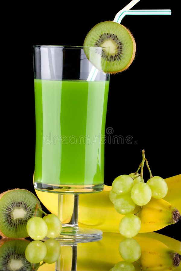 Juice and fresh fruits - organic, health drinks se. Organic juice made from kiwi, green grapes and bananas surrounded by fresh fruits. Series about organic and royalty free stock photography