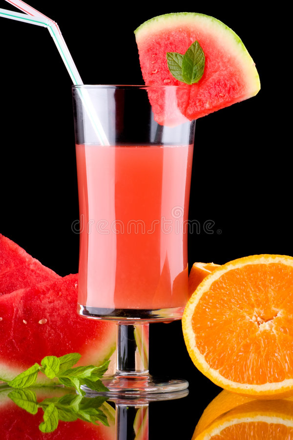 Juice and fresh fruits - organic, health drinks se. Organic juice made from watermelon, oranges and grapefruit surrounded by fresh fruits. Series about organic royalty free stock image
