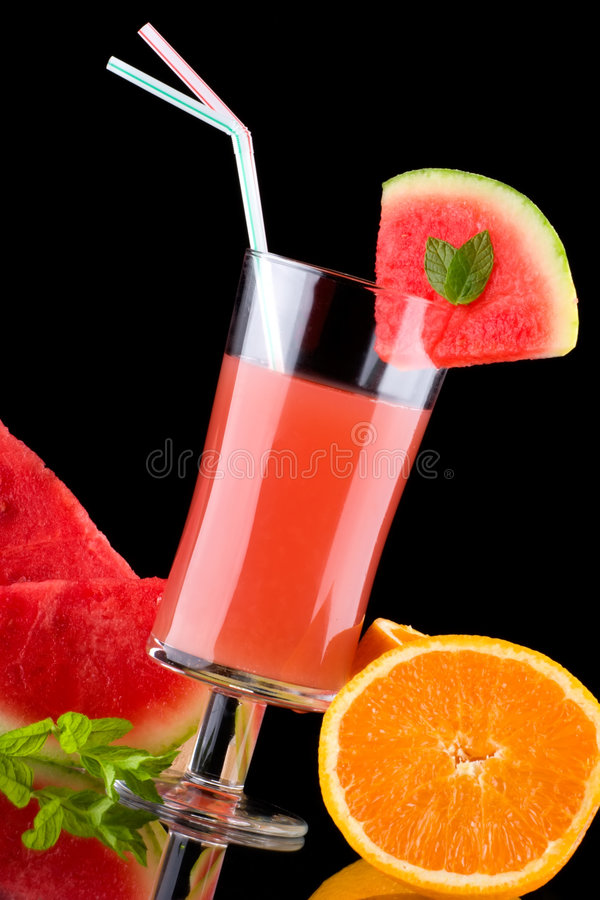 Juice and fresh fruits - organic, health drinks se. Organic juice made from watermelon, oranges and grapefruit surrounded by fresh fruits. Series about organic stock photo