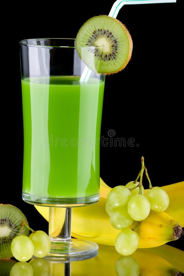 Juice and fresh fruits - organic, health drinks se. Organic juice made from kiwi, green grapes and bananas surrounded by fresh fruits. Series about organic and royalty free stock photos