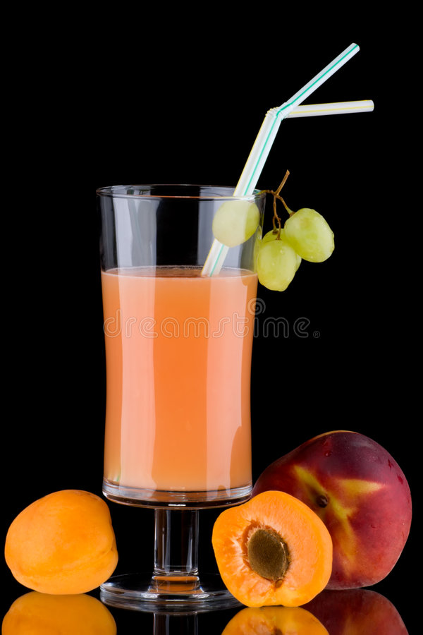 Juice and fresh fruits - organic, health drinks se. Organic juice made from apricots, grapes and peaches surrounded by fresh fruits. Series about organic and stock image