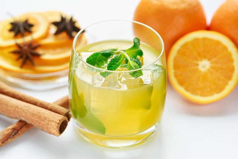 Juice from fresh oranges and spices stock images