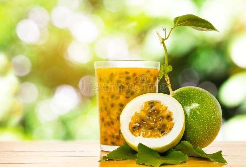 Passion fruit. Juice made with passion fruit on wooden royalty free stock image