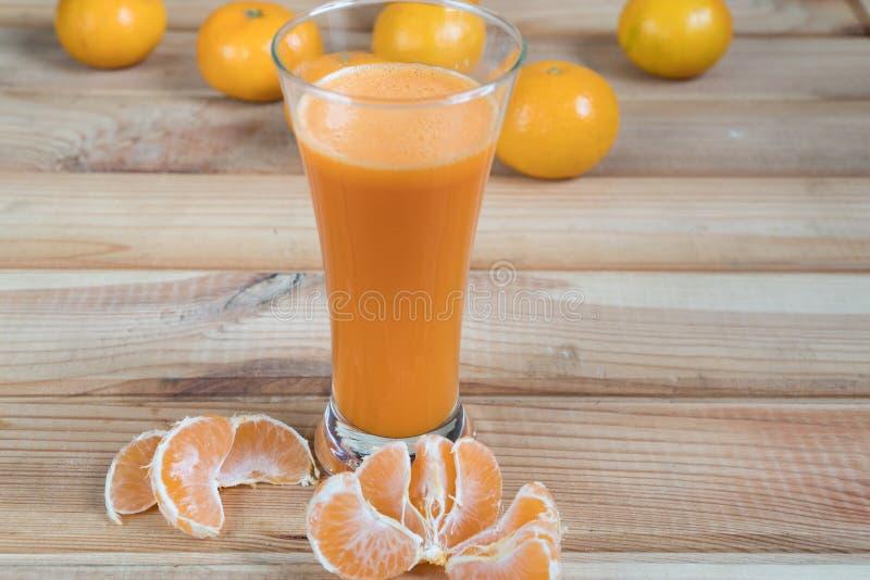 Juice of mandarins. fresh juice. citrus tangerines. natural juice royalty free stock photos
