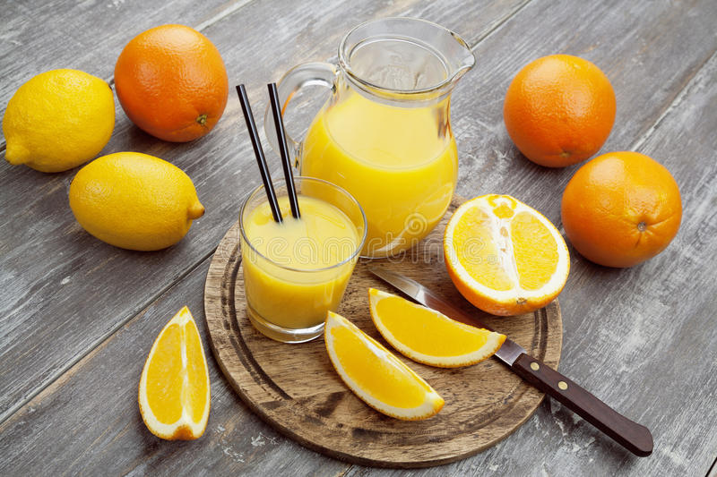 Juice and oranges royalty free stock photography