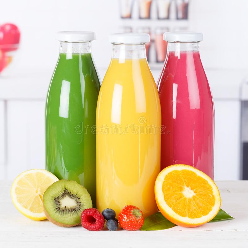 Juice smoothie orange smoothies in kitchen bottle square fruit f. Ruits fresh drink stock photos