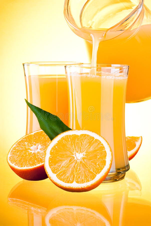 Download Juice To Pour From Pitcher, Oranges With Leaves Stock Photo - Image: 25430810