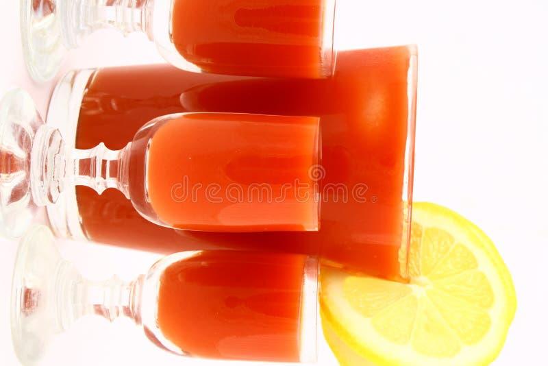 Juice tomato. Red juice and sun flowers stock photos