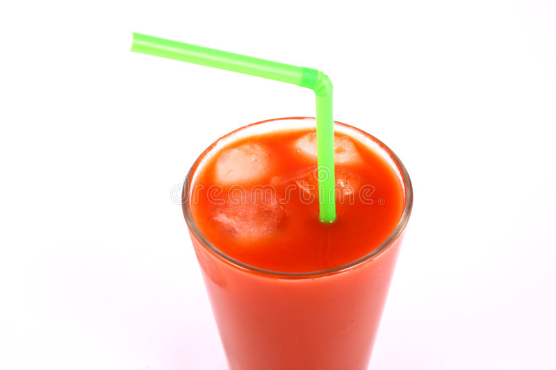 Juice tomato. Red juice and sun flowers stock image