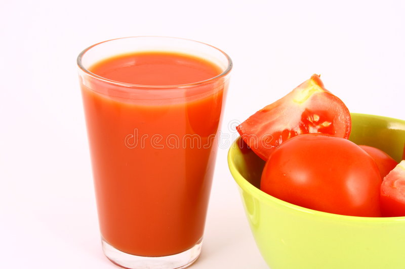 Juice tomato. Close-up of a few tomatoes and a glass of juice stock photos