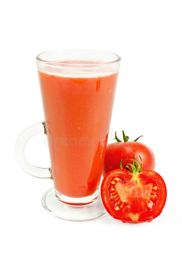 Juice tomato in a tall glass. Tomato juice in a tall glass with the whole and sliced tomato with a light shade on white background royalty free stock image