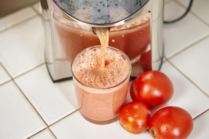 Juicer томата стоковые изображения rf