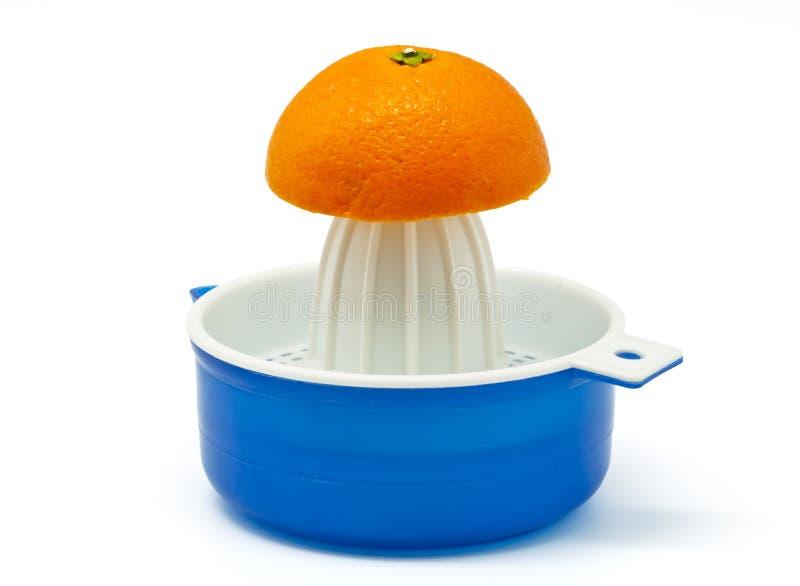 Juicer avec des oranges photos libres de droits