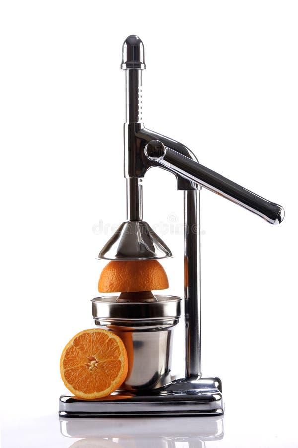 Juicer de citron de chrome et moitiés oranges photos libres de droits