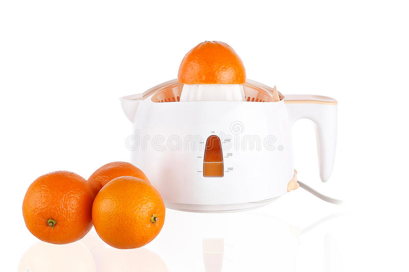 Juicer and oranges stock image