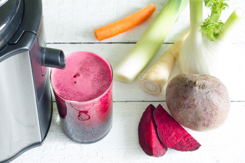 Juicer, red beetroot juice, other vegetables health diet detoxification royalty free stock photo