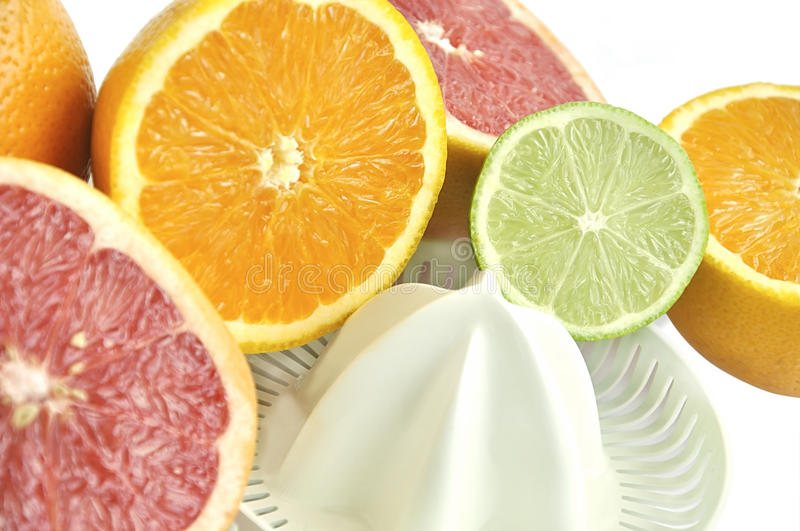 Download Juicer With Slices Of Grapefruit, Orange And Lime. Stock Photos - Image: 9981763