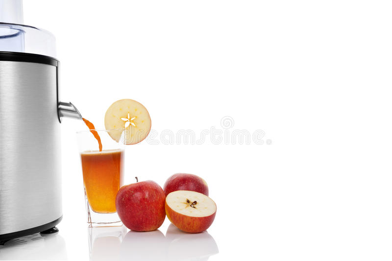 Juicing fresh apples. stock image